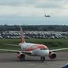 "EasyJet Airbus A319 G-EZDW ""Venezia"" at London Luton Airport, while a sister aircraft lands behind, 13.10.17."