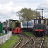 """Ruston & Hornsby 0-4-0 Diesel Electric no. 268881 """"Mazda"""" and 1935-built English Electric Wks. electric & battery loco no. E905 (Spondon Power Station No. 1) at the Electric Railway Museum, Coventry."""