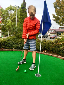Putt putt with Connor while Peter and Amelia are camping