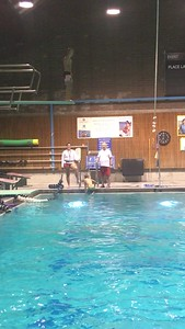 Connor demo's his high dive in diving class