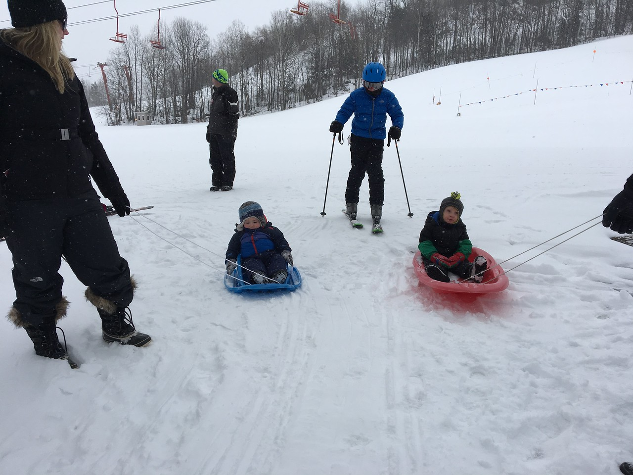 OUR VERY SMALLEST FUTURE SKIERS ( RYAN AND BECKETT) GET OUT ON THEIR SLEDS