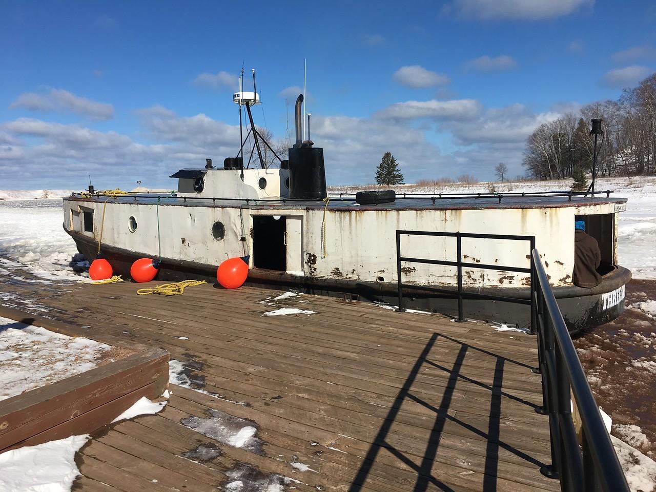 BOAT STUCK IN ICE AT BLACK RIVER HARBOR
