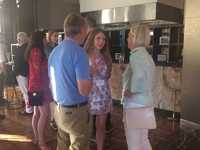 Students and alumni mingle at a welcome cocktail reception - Joy Allen