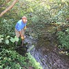 DOUG CLEANING OUT WHAT THE BEAVERS DEPOSITED AT THE CULVERT
