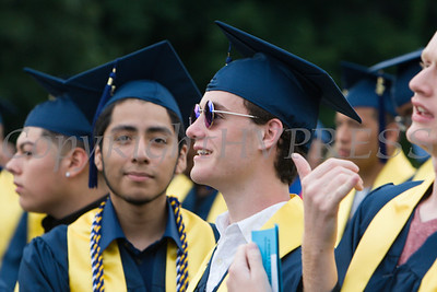 Students look for relatives in the audience as Newburgh Free Academy held its 152nd Commencement Exercises for the graduating Class of 2017 on Academy Field in the City of Newburgh, NY on Thursday, June 22, 2017. Hudson Valley Press/CHUCK STEWART, JR.