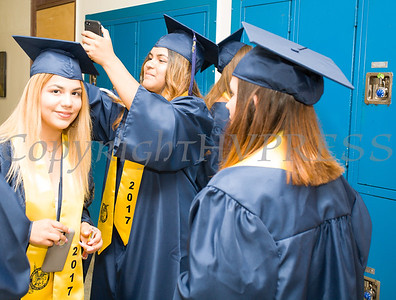 Lesli Juarez help Yavlika Rivera with her cap prior to Newburgh Free Academy's 152nd Commencement Exercises for the graduating Class of 2017 on Academy Field in the City of Newburgh, NY on Thursday, June 22, 2017. Hudson Valley Press/CHUCK STEWART, JR.