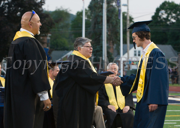 Newburgh Free Academy graduates receive their diplomas during the 152nd Commencement Exercises for the graduating Class of 2017 on Academy Field in the City of Newburgh, NY on Thursday, June 22, 2017. Hudson Valley Press/CHUCK STEWART, JR.