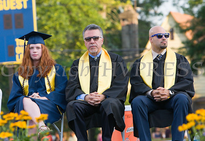Valedictorian Katherine Gravel, Principal Matteo Doddo, and Superintendent of Schools Dr. Roberto Padilla listen to remarks during the Newburgh Free Academy 152nd Commencement Exercises for the graduating Class of 2017 on Academy Field in the City of Newburgh, NY on Thursday, June 22, 2017. Hudson Valley Press/CHUCK STEWART, JR.