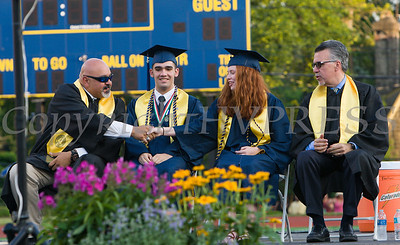 Newburgh Free Academy Principal Raul Rodriguez shakes hands with Valedictorian Katherine Gravel as Salutatorian Juan Peticco and Principal Matteo Doddo look on during Newburgh Free Academy's 152nd Commencement Exercises for the graduating Class of 2017 on Academy Field in the City of Newburgh, NY on Thursday, June 22, 2017. Hudson Valley Press/CHUCK STEWART, JR.