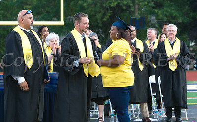 Rhonda Valentine-Free accepts a diploma on behalf of her daughter Omani who was killed at a Halloween party in October during Newburgh Free Academy's 152nd Commencement Exercises for the graduating Class of 2017 on Academy Field in the City of Newburgh, NY on Thursday, June 22, 2017. Hudson Valley Press/CHUCK STEWART, JR.