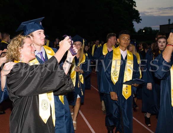 Newburgh Free Academy graduates recess from Academy Field following the 152nd Commencement Exercises for the graduating Class of 2017 on Thursday, June 22, 2017. Hudson Valley Press/CHUCK STEWART, JR.
