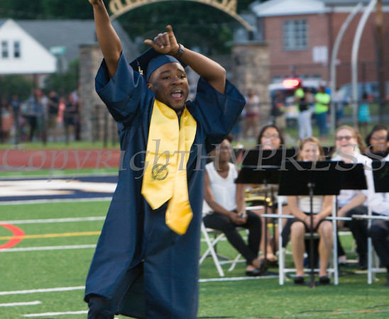 A Newburgh Free Academy graduate celebrates after receiving his diploma during the 152nd Commencement Exercises for the graduating Class of 2017 on Academy Field in the City of Newburgh, NY on Thursday, June 22, 2017. Hudson Valley Press/CHUCK STEWART, JR.