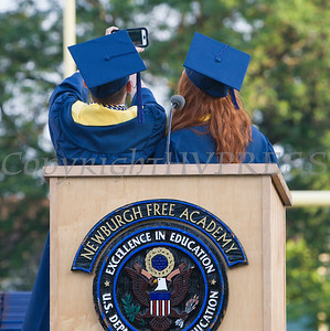 Salutatorian Juan Peticco and Valedictorian Katherine Gravel take a selfie during the Newburgh Free Academy 152nd Commencement Exercises for the graduating Class of 2017 on Academy Field in the City of Newburgh, NY on Thursday, June 22, 2017. Hudson Valley Press/CHUCK STEWART, JR.