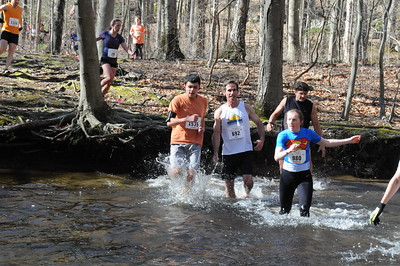 Race women's winner Jacqueline Kehoe at the first water crossing. (photo by Keith Realander)