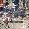 Checking for lost contact lens in Mud Flats  (photo by Chris Reinke)