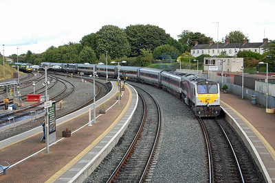 208 departs from Drogheda with the 1405 'Enterprise' service from Belfast Central to Dublin Connolly. Just behind the signal box in the background is the former Navan line, which still sees daily freight traffic as far as Tara Mines(08/09/2017)