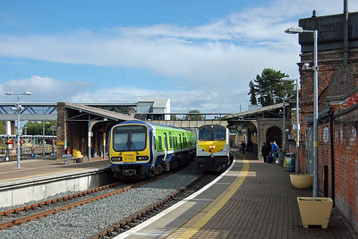 228 arrives at Drogheda with the 1520 from Dublin Connolly to Belfast Central as a 2x00 Class DMU waits to return back south (08/09/2017)