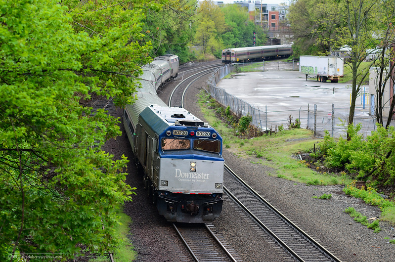 Boston bound Downeaster passes outbound 2311 at Somerville Jct on the New Hampshire Line.
