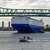 The auto carrier Glovis Sun heads out to sea under the Toblin Bridge in Boston Harbor.