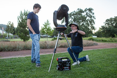 Martin Bradly shows Jalen Travers how to level a telescope at Observatory Park in Ukiah. Chris Pugh-Ukiah Daily Journal.