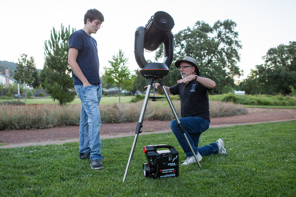 . Martin Bradly shows Jalen Travers how to level a telescope at Observatory Park in Ukiah. Chris Pugh-Ukiah Daily Journal.