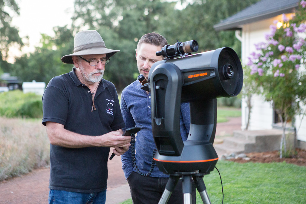 . Martin Bradley, Community Services Assistant and Park Interpreter for the Observatory aligns a telescope with the help of park guest Nick Barth. Chris Pugh-Ukiah Daily Journal.