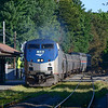 Downeaster train 690 passes through Melrose Cedar Park on the Western Route with the Dome Car Ocean View. Weekend outages on the Lowell line have moved the Downeaster trains to the Haverhill Line providing a chance to see south facing loco hauled trains through early October.