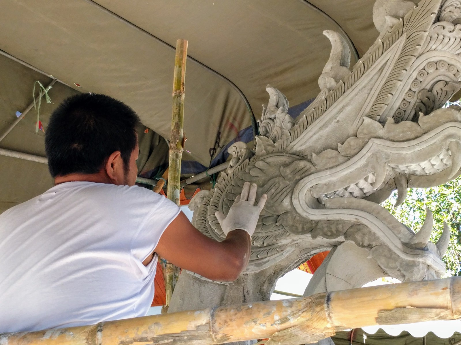 Concrete Sculptor Creating Naga at New Temple