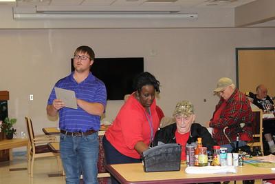 Louisiana Farm Bureau District I fieldman Chris Long assists veterans with their bingo game.