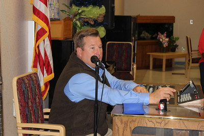 Louisiana Farm Bureau District I board member Marty Wooldridge assists the Women's Leadership Committee Veteran's Home project, by calling numbers for the bingo games.