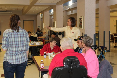 Louisiana Farm Bureau Women's Leadership Committee District I director Cystal Wooldridge assist veterans at the Bossier Veteran's Home with their bingo game. She participated in one of the Louisiana Farm Bureau Women's Leadership Committee Veteran's Home visits. Looks like she may have the winning card!