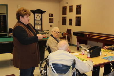 Tena Dodson of Bossier Parish assist veterans at the Bossier Veteran's Home with their bingo game. She participated in one of the Louisiana Farm Bureau Women's Leadership Committee Veteran's Home visits.