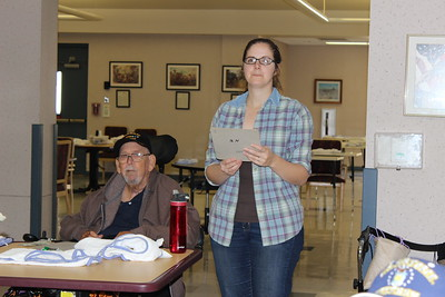 Megan Caughern of Caddo Parish assist veterans at the Bossier Veteran's Home with their bingo game. She participated in one of the Louisiana Farm Bureau Women's Leadership Committee Veteran's Home visits.