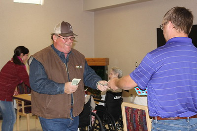 Loyd Dodson of Bossier Parish assist veterans at the Bossier Veteran's Home with their bingo game. She participated in one of the Louisiana Farm Bureau Women's Leadership Committee Veteran's Home visits.