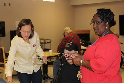 Louisiana Farm Bureau Women's Leadership Committee District I director Cystal Wooldridge assist veterans at the Bossier Veteran's Home with their bingo game. She participated in one of the Louisiana Farm Bureau Women's Leadership Committee Veteran's Home visits.