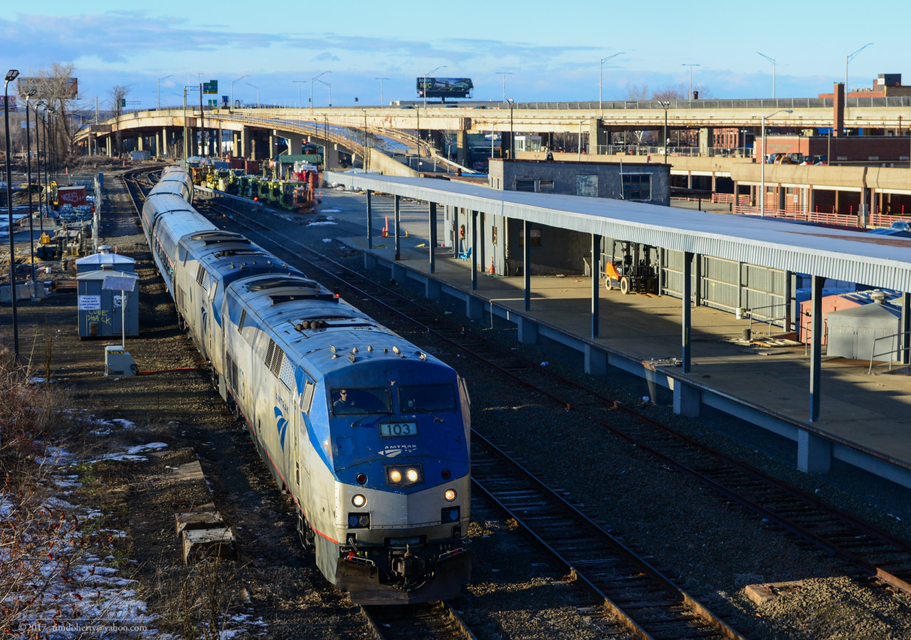 Amtrak train 54, the Vermonter, heads south on the Springfield line passing the Sweeny Building on January 1, 2017.