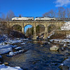 On New Year's Day the southbound Vermonter crosses the Fall River on the 1846 stone viaduct at Bernardston.