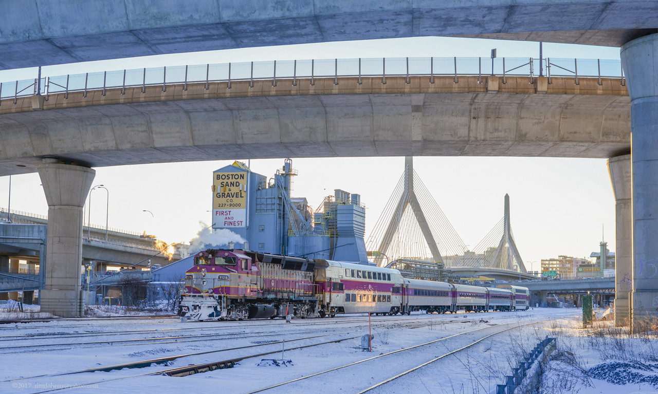 MBTA 1125 heads outbound from North Station on cold February morning.