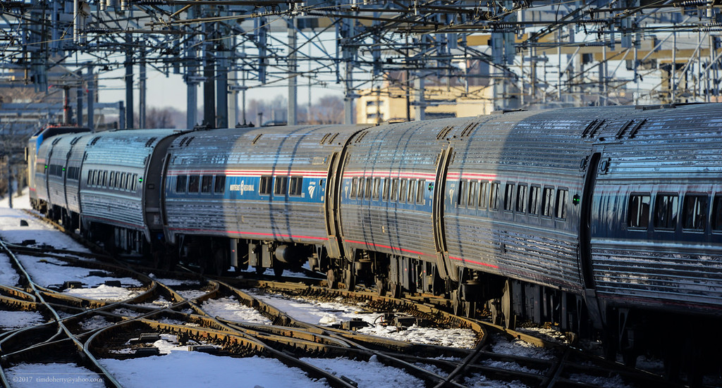 The consist for Amtrak 99 backs into South Station from Southampton Street in Boston.