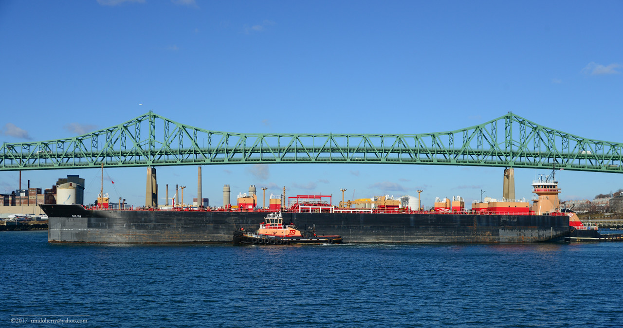 The Tug Freedom helps the Meredith Reinauer and a barge out to sea.
