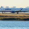 An irreverently named jetBlue plane at Logan Airport.