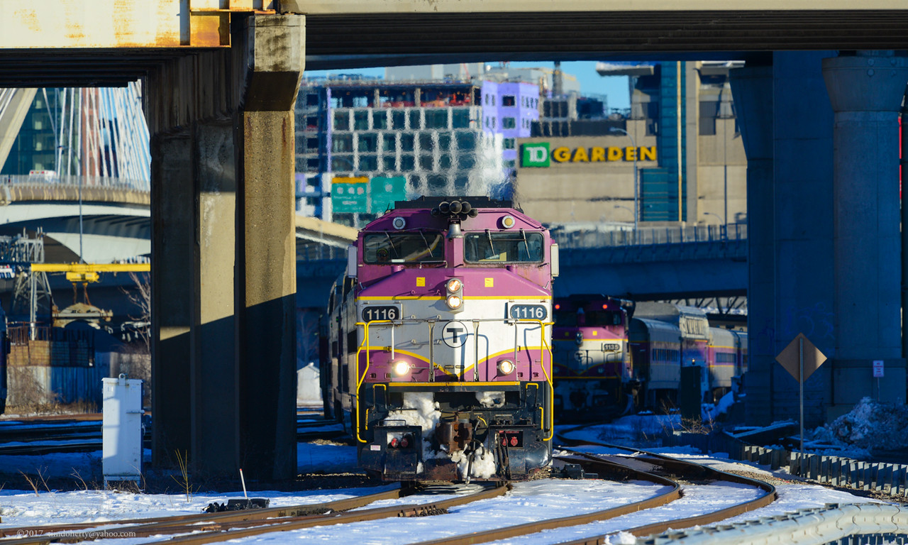MBTA Fitchburg Line train 421 passes the inbound train 422.