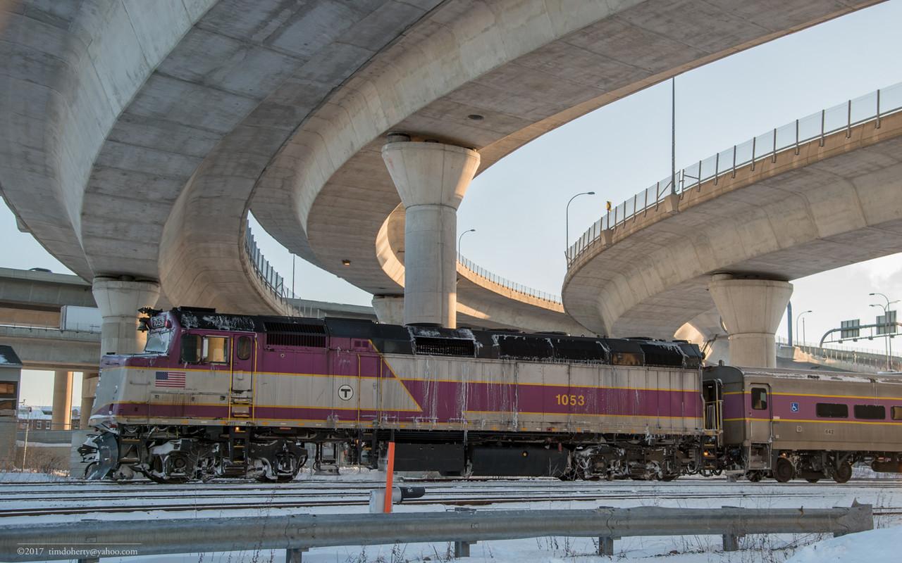 MBTA 1053 heads inbound to North Station under the I-93 ramps.