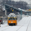 A Mattapan bound PCC has just left Ashmont on a snow covered Saturday.
