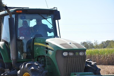 Louisiana Farm Bureau President Ronnie Anderson tags along in a cane harvester, to experience sugarcane harvest firsthand.