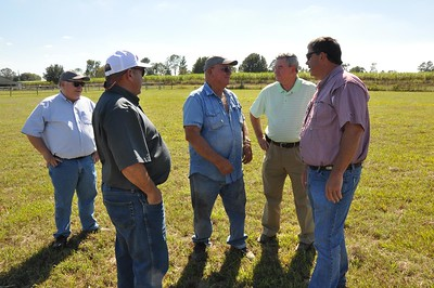 St. Martin Parish sugarcane farmer Bernard Laviolette Jr, middle, talks with Louisiana Farm Bureau 3rd Vice President Richard Fontenot, American Farm Bureau President Zippy Duvall, Louisiana Farm Bureau 1st Vice President and Rapides Parish sugarcane farmer Jim Harper and Louisiana Farm Bureau Federation Associate Commodity Director Brian Breaux about his role on the farm.
