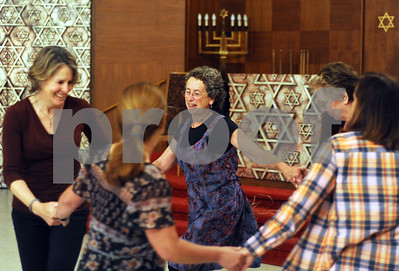 "Robert Layman / Staff Photo  Judy Stern, center, leads a night of dancing with students at the Rutland Jewish Center Thursday night. Stern taught styles from European countries as well as Israeli folk which is shown here. The group performs Tzadik Katamar, which from Hebrew translates to  ""The Righteous Man Shall Flourish."""