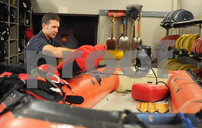 Robert Layman / Staff Photo  Rutland City Fire Fighter Nate Elwert unfolds a drysuit among other pieces of equipment used by Vermont Task Force 1 while being deployed in Texas for hurricane Harvey relief. This photo was taken at the RCFD, September 14, 2017.