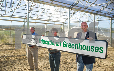 Robert Layman / Staff Photo Chuck Rose, left, and Rich Carlson, right, of the Rotary Club of Rutland stand with Grec Cox, center, at the Vermont Farmer's Food Centers  new educational greenhouses Sunday, October 1,2017.