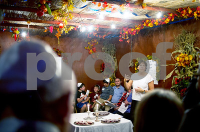Robert Layman / Staff Photo Rabba Kaya Stern-Kaufman, right,  the new rabba for the Rutland Jewish Center, leads the congregation during Sukkot, a Jewish holiday that celebrates the season's harvest by eating in an outdoor structure called a sukkah, shown here.